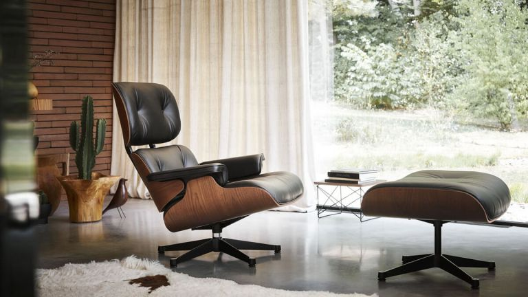 Designer furniture: Eames recliner chair in living room by large window