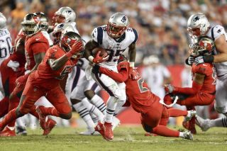 New England Patriots running back Mike Gillislee (35) is tackled by Tampa Bay Buccaneers cornerback Vernon Hargreaves III (28) and linebacker Kendell Beckwith (51) during an NFL football game on Oct. 05, 2017.