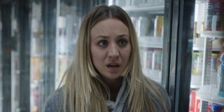kaley cuoco's cassie standing in convenience store cooler section on the flight attendant