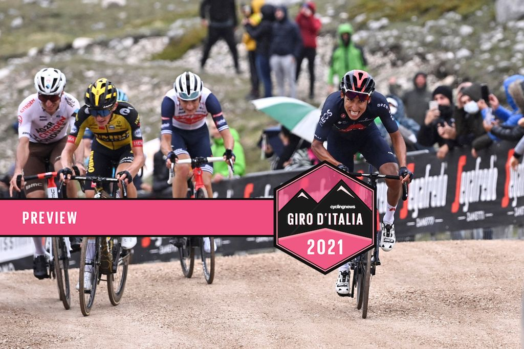 Team Ineos rider Colombia's Egan Bernal (front R) reacts as prepares to cross the finish line to win the ninth stage of the Giro d'Italia 2021 cycling race, 158 km between Castel di Sangro and Campo Felice (Rocca di Cambio) on May 16, 2021. (Photo by Fabio FERRARI / POOL / AFP) / The erroneous mention[s] appearing in the metadata of this photo by Dario BELINGHERI has been modified in AFP systems in the following manner: [Fabio Ferrari] instead of [Dario Belingheri]. Please immediately remove the erroneous mention[s] from all your online services and delete it (them) from your servers. If you have been authorized by AFP to distribute it (them) to third parties, please ensure that the same actions are carried out by them. Failure to promptly comply with these instructions will entail liability on your part for any continued or post notification usage. Therefore we thank you very much for all your attention and prompt action. We are sorry for the inconvenience this notification may cause and remain at your disposal for any further information you may require. (Photo by FABIO FERRARI/POOL/AFP via Getty Images)