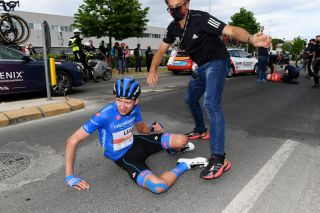 CATTOLICA ITALY MAY 12 Joseph Lloyd Dombrowski of United States and UAE Team Emirates blue mountain jersey are involved in an accident during the 104th Giro dItalia 2021 Stage 5 a 177km stage from Modena to Cattolica Crash Injury girodiitalia Giro on May 12 2021 in Cattolica Italy Photo by Tim de WaeleGetty Images