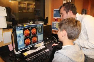 Researchers used a type of magnetic resonance imaging (MRI) to look at the tissue density of the brains of kids and adults.