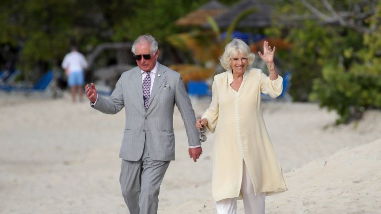 Prince Charles and Camilla, Prince Charles, Prince of Wales and Camilla, Duchess of Cornwall attend an engagement on the beach during their official visit to Grenada on March 23, 2019 in Saint George's, Grenada.