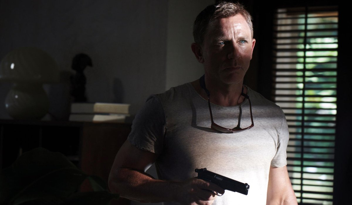 No Time To Die Daniel Craig in shadow, with a gun