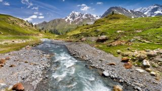 A stream with mountains in the background