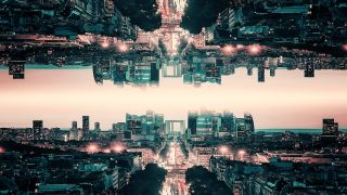 View of a cityscape with it's reflection above, depicting parallel worlds.