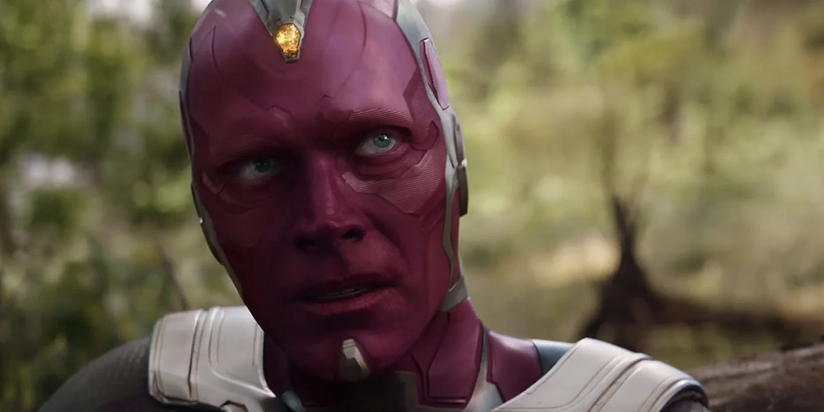 Vision sits on the ground in a forest in 'Avengers: Infinity War'
