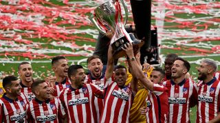 Atletico Madrid´s players celebrate with the trophy at the Wanda Metropolitano stadium in Madrid on May 23, 2021 after winning the Spanish Liga Championship title.