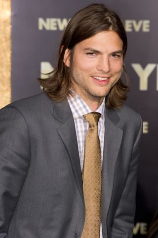 "Actor Ashton Kutcher, star of CBS's ""Two and a Half Men,"" will ride on Virgin Galactic's SpaceShipTwp suborbital space plane."