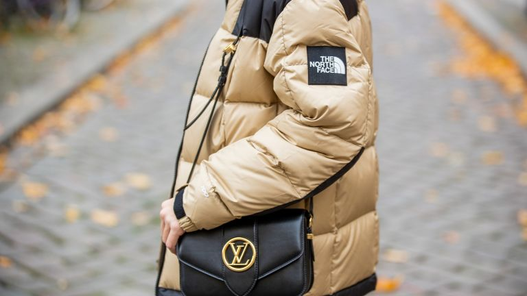 BERLIN, GERMANY - OCTOBER 22: Sonia Lyson is seen wearing Lululemon leggings, The North Face puffer jacket, Louis Vuitton bag on October 22, 2020 in Berlin, Germany. (Photo by Christian Vierig/Getty Images)