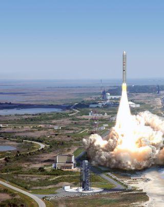 An artist's illustration of an Orbital Sciences Taurus 2 rocket launcing from Wallops Flight Facility in Wallops Island, Va.