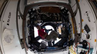 Flight Engineer Soichi Noguchi with his Nikon D5 in the ISS Cupola