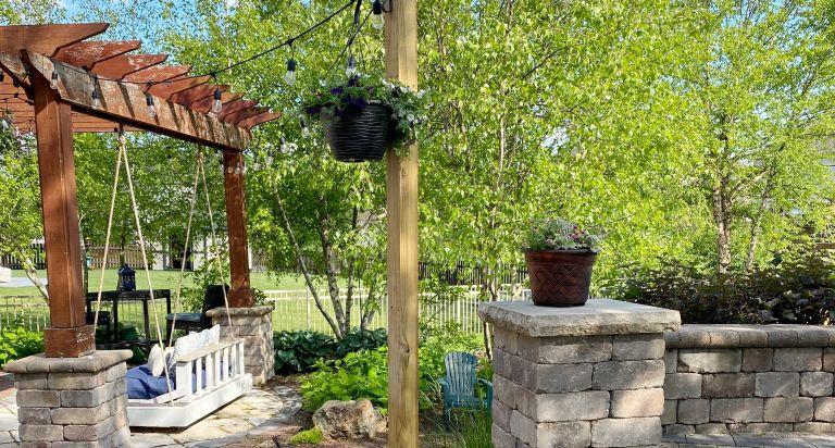 wine barrel planter holding string lights