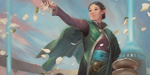 woman releasing flower petals magic the gathering
