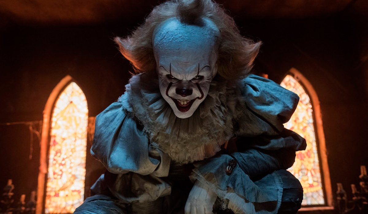 Pennywise the Dancing Clown with a demented smile in IT