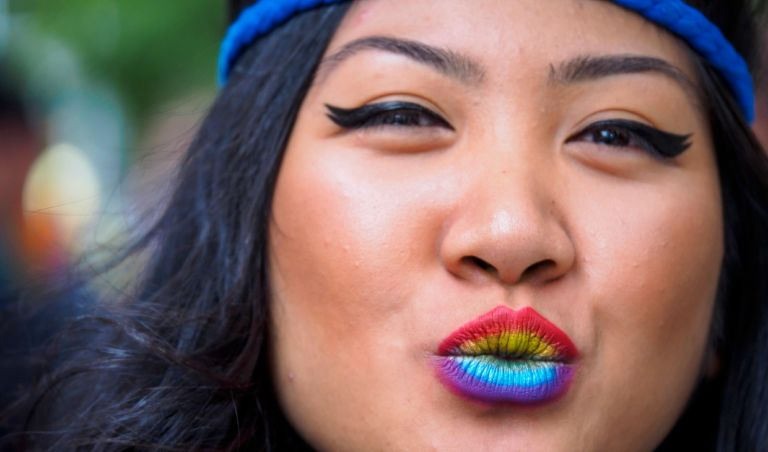 United States, Washington, Seattle Gay Pride Parade, June 28th, 2015. Woman with rainbow colored lips. MR.