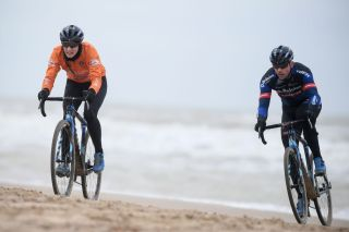 Belgian former cyclocross champion Sven Nys R and Dutch Lucinda Brand ride on a beach during a track reconnaissance and training session ahead of the world championships cyclocross cycling in Oostende on January 28 2021 The worlds are taking place this weekend Photo by DAVID STOCKMAN Belga AFP Belgium OUT Photo by DAVID STOCKMANBelgaAFP via Getty Images