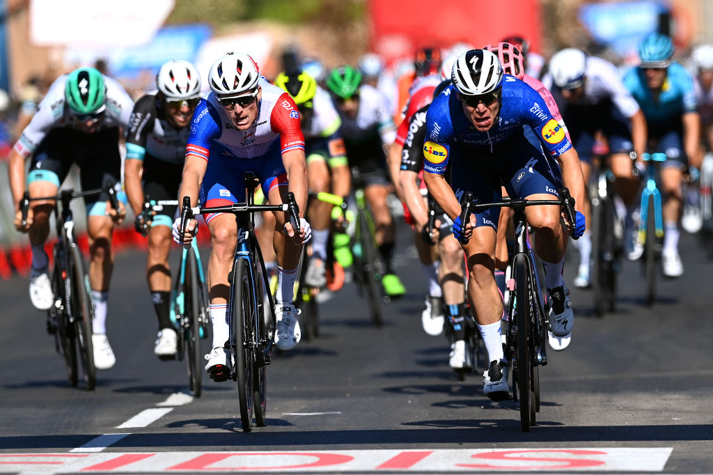 MOLINA DE ARAGON SPAIN AUGUST 17 Fabio Jakobsen of Netherlands and Team Deceuninck QuickStep sprints to win ahead of Arnaud Demare of France and Team Groupama FDJ during the 76th Tour of Spain 2021 Stage 4 a 1639km stage from El Burgo de Osma to Molina de Aragn 1134m lavuelta LaVuelta21 on August 17 2021 in Molina de Aragn Spain Photo by Stuart FranklinGetty Images