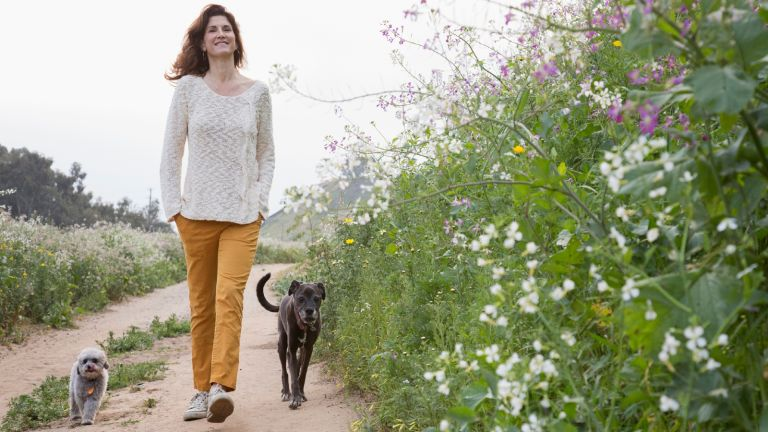 Walking for weight loss: woman walking with dog