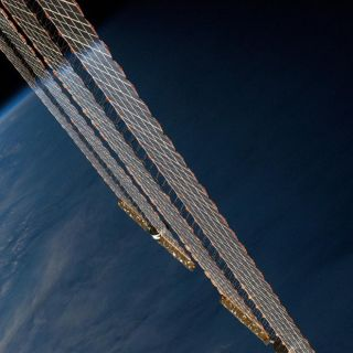 Earth's Horizon Reflected on ISS Solar Arrays