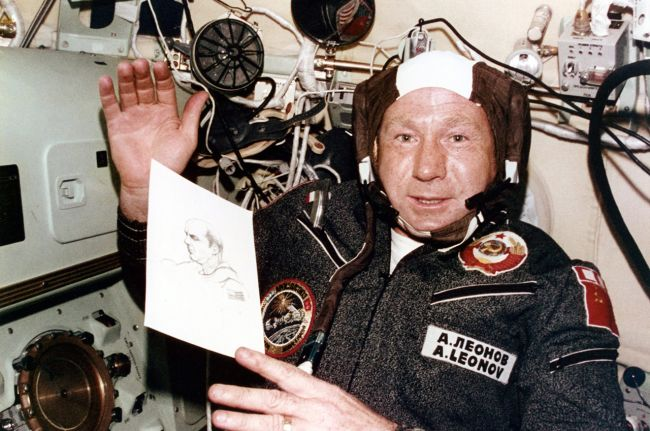 Cosmonaut Alexei Leonov aboard the Apollo-Soyuz Test Project with a sketch he made of one of his American crewmates.
