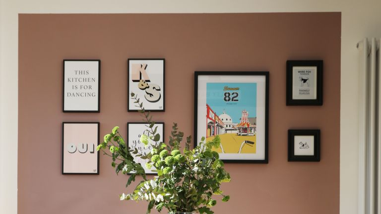 pink painted picture wall with gallery wall of art prints