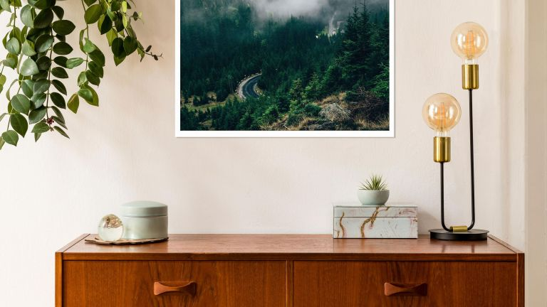 sideboard with framed art and decor pieces