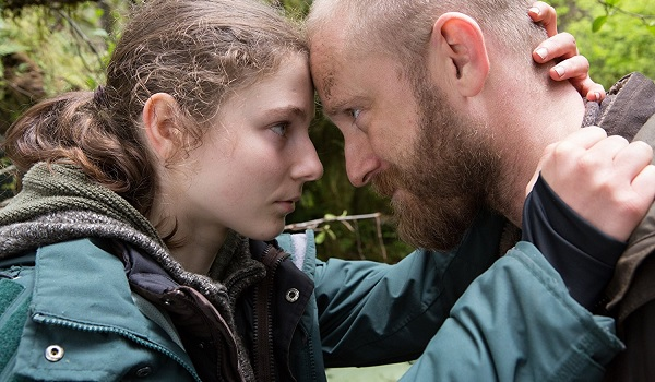 Leave No Trace Thomasin McKenzie Ben Foster heads together in the woods
