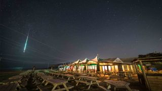 How to photograph meteors and meteor showers - a meteor streaks across the night sky