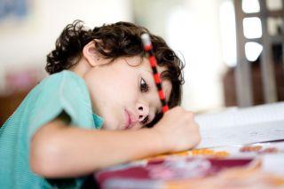 Young boy doing homework.
