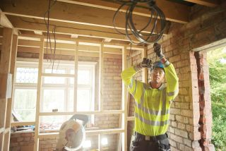 local electrician working on building project