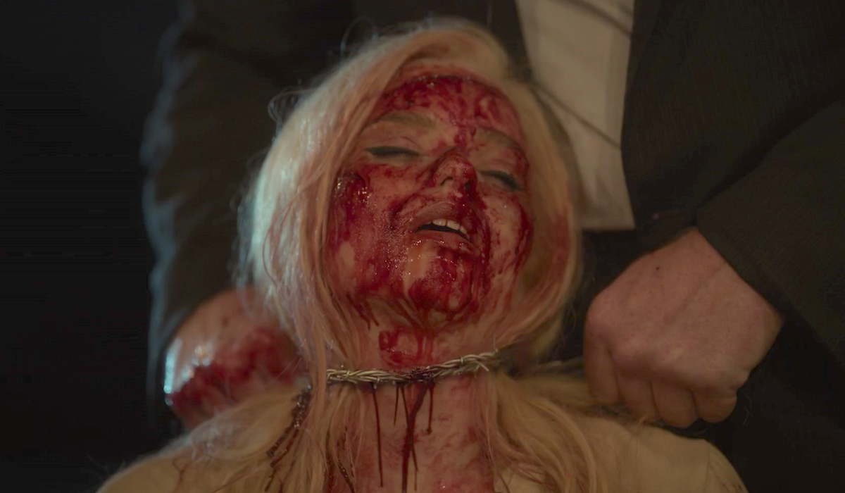 christina being killed with barb wire lovecraft country