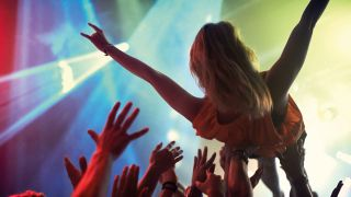 a woman crowdsurfing