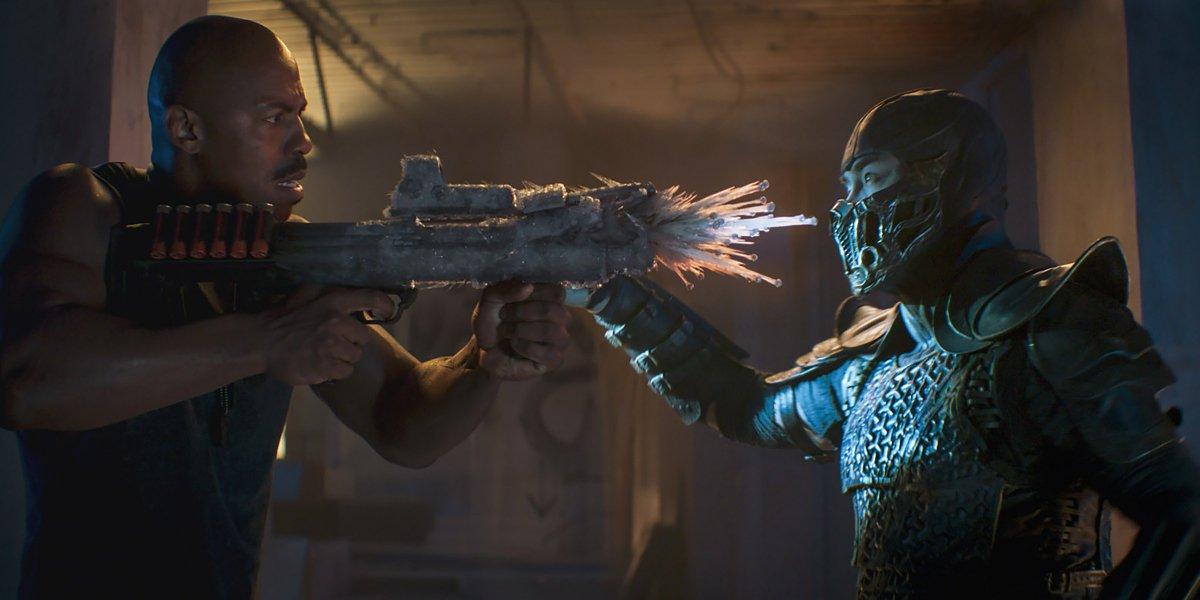 Mehcad Brooks shoots his frozen shotgun at Joe Taslim in Mortal Kombat.
