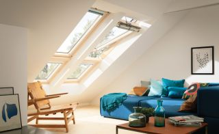 Living room with blue sofa and rooflights