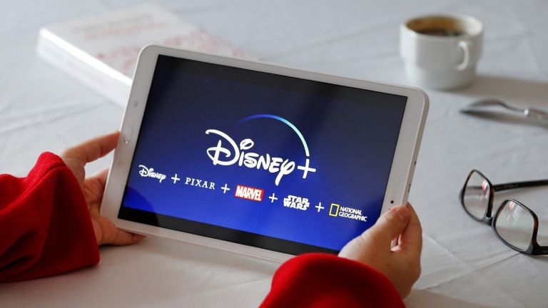 Disney + logo is displayed on the screen of a tablet