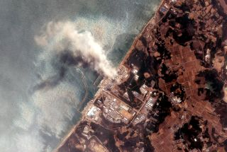 Smoke pours out of Fukushima Daiichi power plant shortly after a devastating earthquake and tsunami struck in 2011.