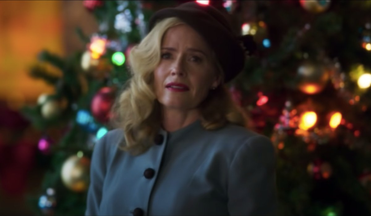 Greyhound Elizabeth Shue looks back wistfully in front of a Christmas tree