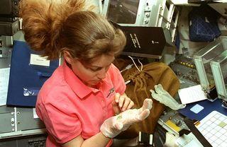 Astronaut Cady Coleman, gravity, plants