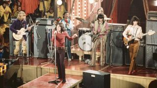The Rolling Stones perform live on stage on the set of the Rolling Stones Rock and Roll Circus at Intertel TV Studio in Wembley, London on 11th December 1968