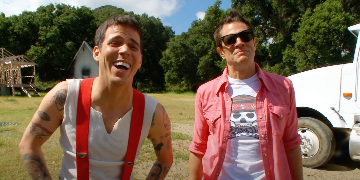 Steve-O laughing and hanging out with Johnny Knoxville on the set of Jackass