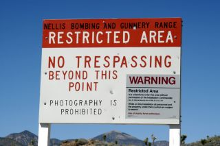 As this sign outside of Nevada's infamous Area 51 military base reminds would-be visitors, guards are authorized to respond to trespassers with deadly force.