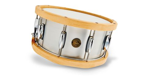 That's brushed aluminium and the drum's chunky hoops are 13-ply rock maple