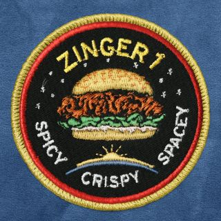 A mission patch designed by Kentucky Fried Chicken for a promotional campaign that will place a chicken sandwich on a high-altitude balloon.