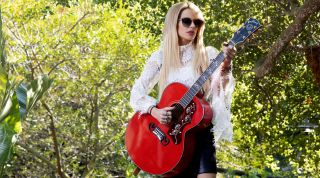 Orianthi with her new signature Gibson SJ-200 acoustic