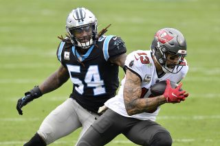 Tampa Bay Buccaneers receiver Mike Evans catches a pass in front of Shaq Thompson of the Carolina Panthers during their game at Bank of America Stadium on Nov. 15, 2020 in Charlotte, North Carolina.