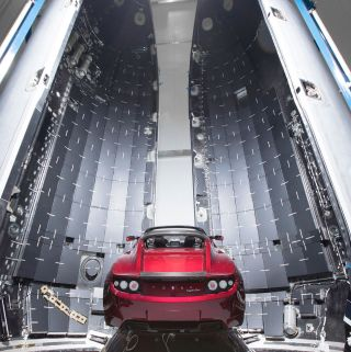 Elon Musk's midnight cherry red Tesla Roadster is seen before being enclosed in a payload fairing for SpaceX's first Falcon Heavy rocket launch, slated for January 2018, in this image released by Musk on Dec. 22, 2017.