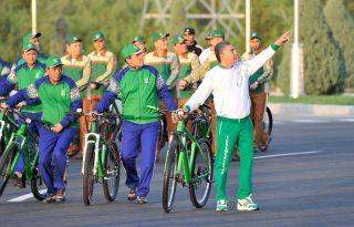 Turkmenistan's President Gurbanguly Berdymukhamedov (R) gestures as he attends World Bicycle Day in Ashgabat on June 3, 2020