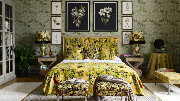 Yellow maximalist bedroom with chinoiserie moss green wallpaper and floral bedding by Mindthegap