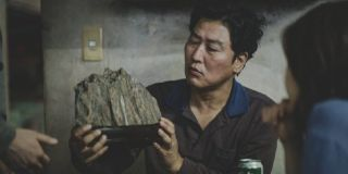 Parasite Kang-ho Song holding the infamous rock